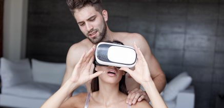 Young couple with VR headset enjoying VR.SEX